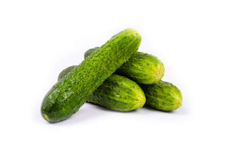 bunch of fresh cucumbers isolated on white background.