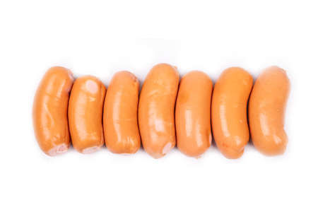 smoked sausages in a row isolated on white background.