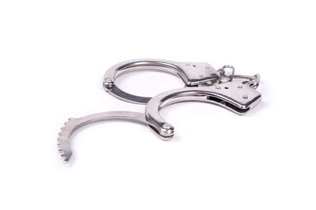 open handcuffs isolated on white background . 免版税图像