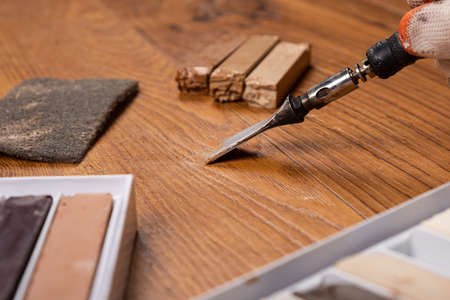 restoration of a wooden surface with wax pencils