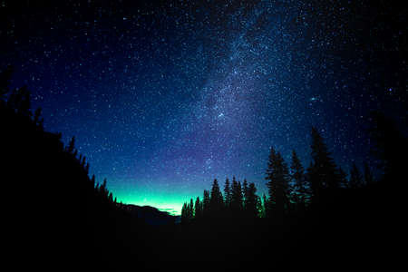 Star gazing the Milky Way with Northern Lights at Lake Moraine in Banff National Park 写真素材