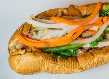 Close up shot of a traditional Banh Mi Sandwich. Banh Mi Sandwiches came from the influence of the French colonization.. Banco de Imagens