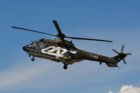 civilian: This is the Eurocopter AS 332 M1 Super Puma T316 from the Swiss Air Force. The Super Puma is suitable for many military and civilian purposes. Here we can see it at the air14 show in Payerne Switzerland on the 30th of August 2014. Editorial