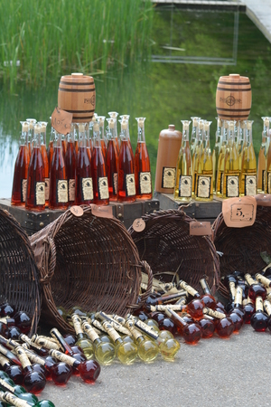 przodek: Beautiful display of various sorts of mead at a medieval market in Germany. Mead is seen as ancestor of fermeted drinks.