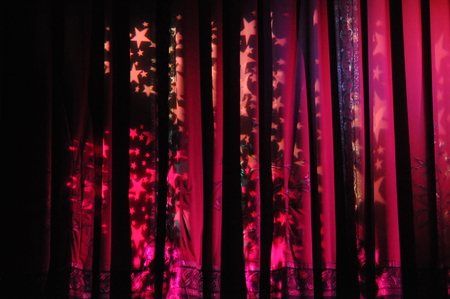 annoucement: Beautiful velvet theater curtain. The show is about to begin.