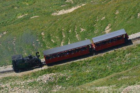 This is the famous steam train from the Brienzer Rothorn Railway BRB, in the Bernese Oberland in Switzerland. The mountain belongs to the Emmental alps. This locomotive no. 6 is the H 23, built in 19331936. It belongs to the second generation steam tracti