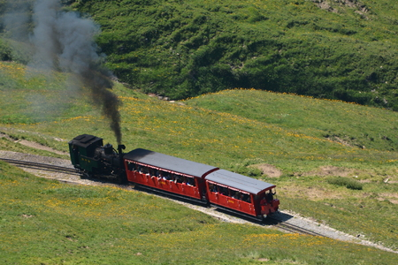 steam traction: This is the famous steam train from the Brienzer Rothorn Railway BRB, in the Bernese Oberland in Switzerland. The mountain belongs to the Emmental alps. This locomotive no. 6 is the H 23, built in 19331936. It belongs to the second generation steam tracti