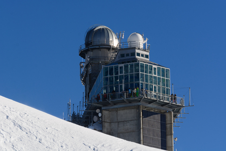 jungfraujoch: Sphinx Observatory  Jungfrau  Jungfraujoch  Top Of Europe. This is the famous Sphinx observatory located above the Jungfraujoch, a col between the mount Jungfrau and the mount Moench, in Switzerland. The observatory is directly connected to the also famou Editorial