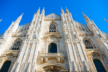 The is the facade of the famous Milan Cathedral Duomo Di Milano is located in northern Italy. It is one of the largest churches in the world and a big attraction for tourists from all over the world.