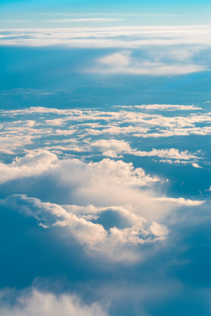 This picture was taken out of an airplane and shows the beautiful cloudscape in the evening light.