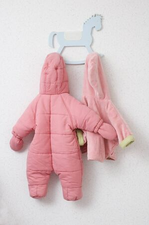 Nursery and baby pink clothes on a coat rack Stock Photo - 9818808