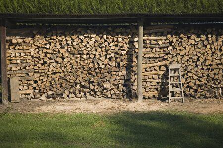 A well-organized timber storage in anticipation of winter Zdjęcie Seryjne