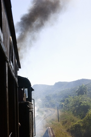 Steam train and Cuban landscape in the valley of Los Angenios near Trinidad photo