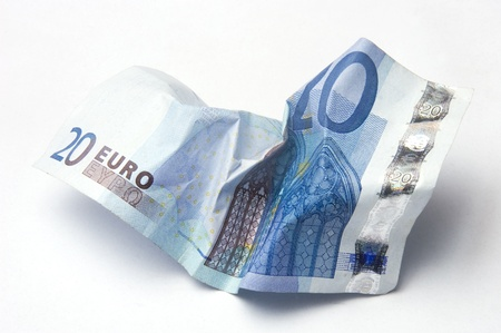 Twenty Euro bill crumpled on light background