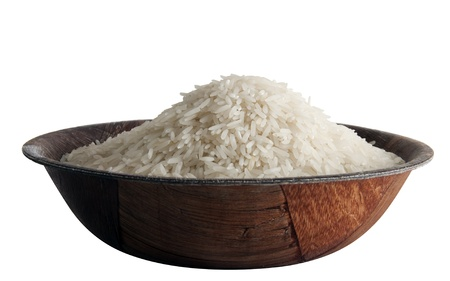 Some basmati rice in palm leaves bowl, isolated on white background Reklamní fotografie