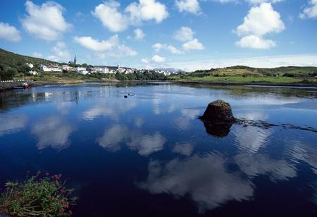 connemara: Bay of Clifden : sea, village, and reflections of dappled sky in Connemara, Ireland