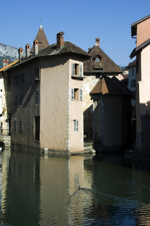 mediaval: Mediaval buildings on small island and river of the Thiou in Annecy old town, france