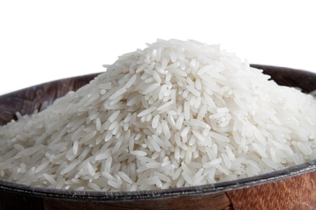 Some grains of Basmati rice in a wooden bowl on white background Reklamní fotografie