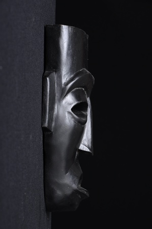 Profile view of a african black wood mask on a black background Stock Photo - 12290751