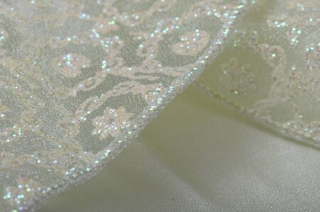 slightly: Slightly colored Lace and shiny satin for texture or background Stock Photo
