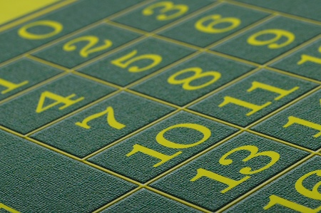 thirteen: Close view of Green carpet of casino roulette and focus on number thirteen Stock Photo