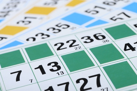 thirteen: Green, blue, yellow bingo cards with focus on number thirteen Stock Photo