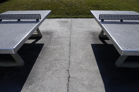 Two outside table tennis and symetric shadows  photo