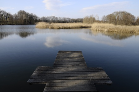 felix: Lake of Saint Felix in Savoy and wooden pontoon forming a cross