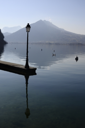 lampost: European Golden age  lampost on Annecy lake in morning
