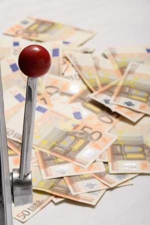 Slot machine and Lot of money fifty euros banknotes photo