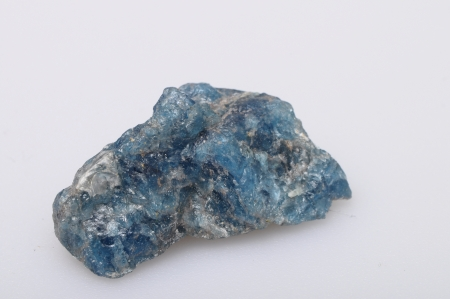 phosphate: Blue apatite stone from Madagascar on light background