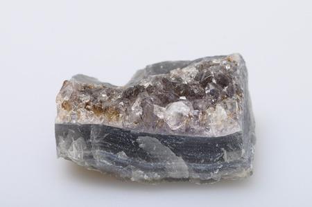 gemology: Purple amethyst quartz stone on light background