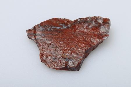 Red jasper stone on light background