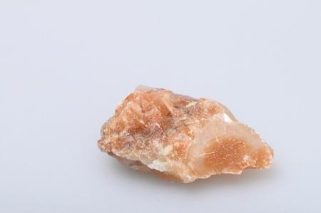 gemology: Orange calcite chunks on light background Stock Photo