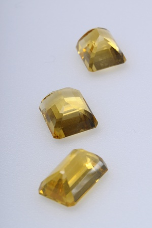 Close up of a citrine gem stone on light background photo