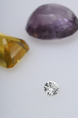 Close up of gems stones, diamond, amethyst,  citrine photo