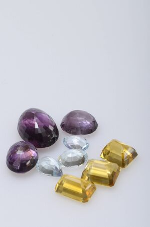 Close up of gems stones, amethyst, aquamarine, citrine photo