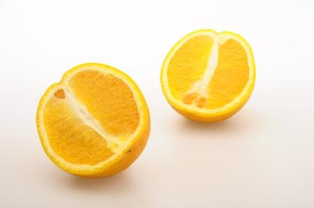 healthy llifestyle: Halves of oranges on white background