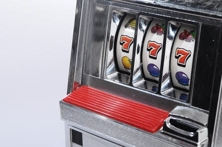 Slot machine and jackpot three seven on light background photo