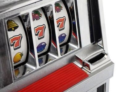machine: Slot machine and jackpot three seven isolated on white background Stock Photo