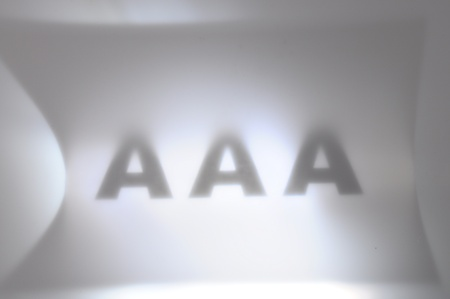 Triple A black and blur for finance and economy background photo