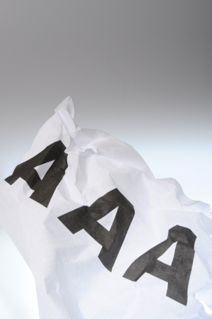 Triple A on crumpled paper on light background photo