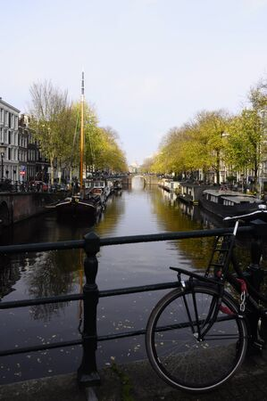Bicycle and view of canal in old city of Amsterdam - Holland photo