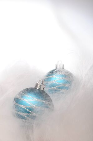 Two blue christmas baubles on white background for merry christmas photo