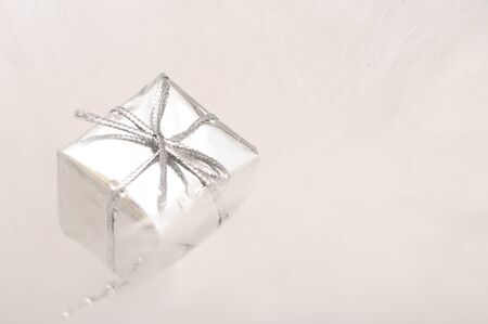 Silver gift box on white blur background for merry christmas photo