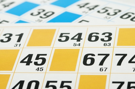 loto: Close up of Yellow and blue Bingo cards and numbers