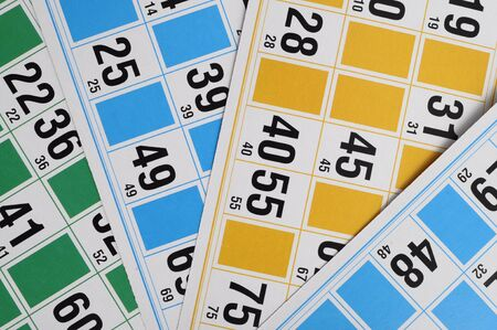 loto: Close up of Yellow, blue and green Bingo cards and numbers