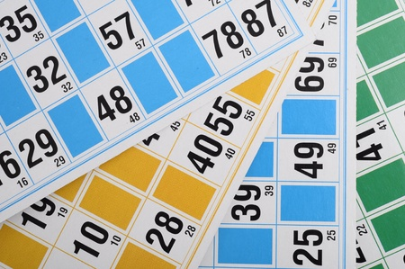 Close up of Yellow, blue and green Bingo cards and numbers photo