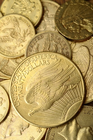 Close up of Gold american coins, on wooden table photo