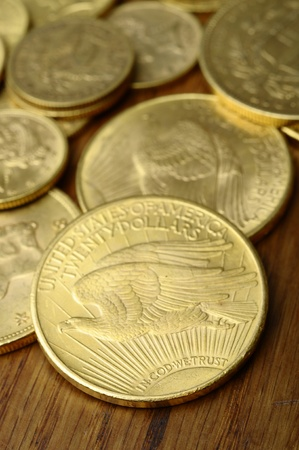 in god we trust: Close up of Gold american coins, on wooden table, with motto in god we trust
